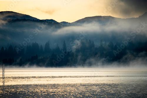 Foto auf Gartenposter Beige Lovely autumnal landscape with fog over the lake.