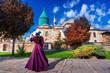 Leinwanddruck Bild - Beautiful girl walking at mosque in Konya, Turkey.