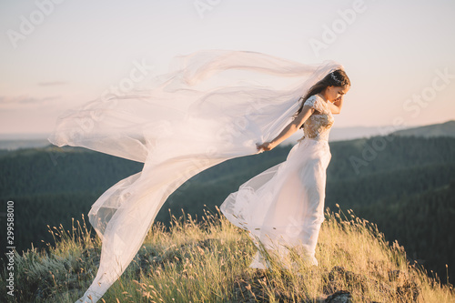 Beautiful bride outdoors in a forest. Wallpaper Mural