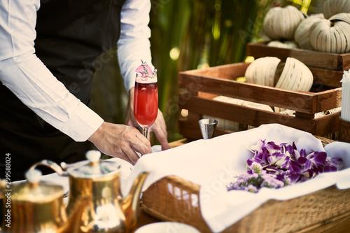 Bartender finished decorating his cocktail. Fototapeta