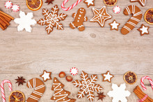 Christmas Gingerbread Cookies, Candy And Baking Items. Top View Double Border On A Wood Background.