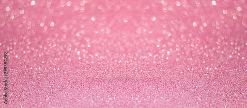 beautiful pink sequins on the glitter sparkle of sun light background with blur bright bokeh