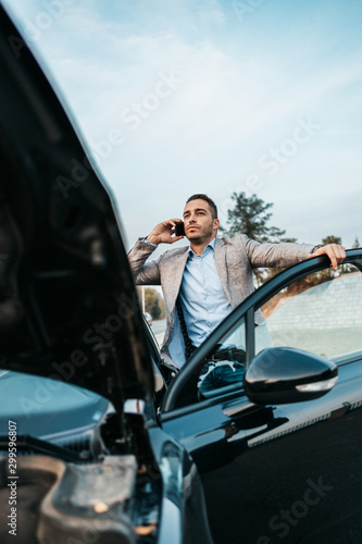 Fotografía Elegant middle age business man calling towing service for help on the road