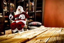 Saint Nicholas Is Sitting In An Armchair. Interior Of A Luxury Home. Table Corner With Empty Space For Your Gifts. Christmas And Magic Time