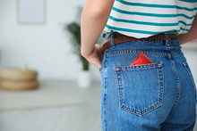 Woman With Condom In Pocket Of Her Jeans Indoors, Closeup. Safe Sex Concept