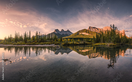 Panorama of Three sisters mountain reflection on pond at sunrise in autumn at Ba Wallpaper Mural