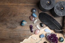 Flat Lay Composition With Different Gemstones On Wooden Background. Space For Text