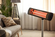 Leinwandbild Motiv Modern electric infrared heater at home. Space for text