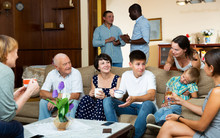 Happy Family Gathering In Parental Home