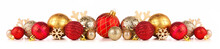 Christmas Border Of Red And Gold Ornaments. Side View Isolated On A White Background.