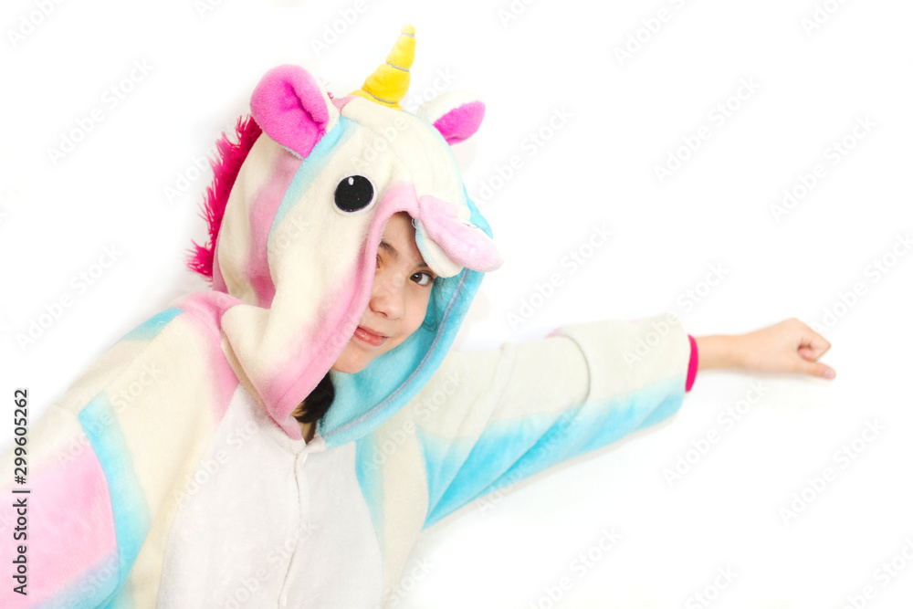 Fototapety, obrazy: Positive young girl posing in funny pajamas. Girl in unicorn kigurumi isolated on white background