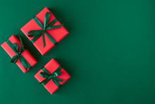 Red Gift Boxes On Green Backgr...