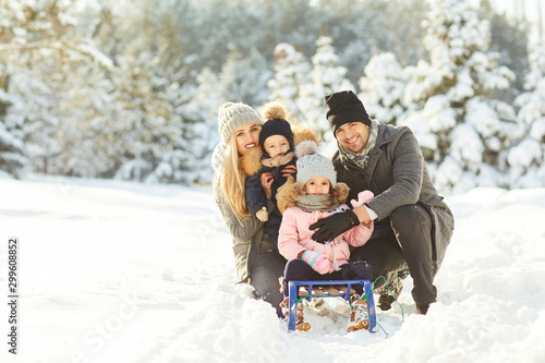 Family smiling in winter in a park