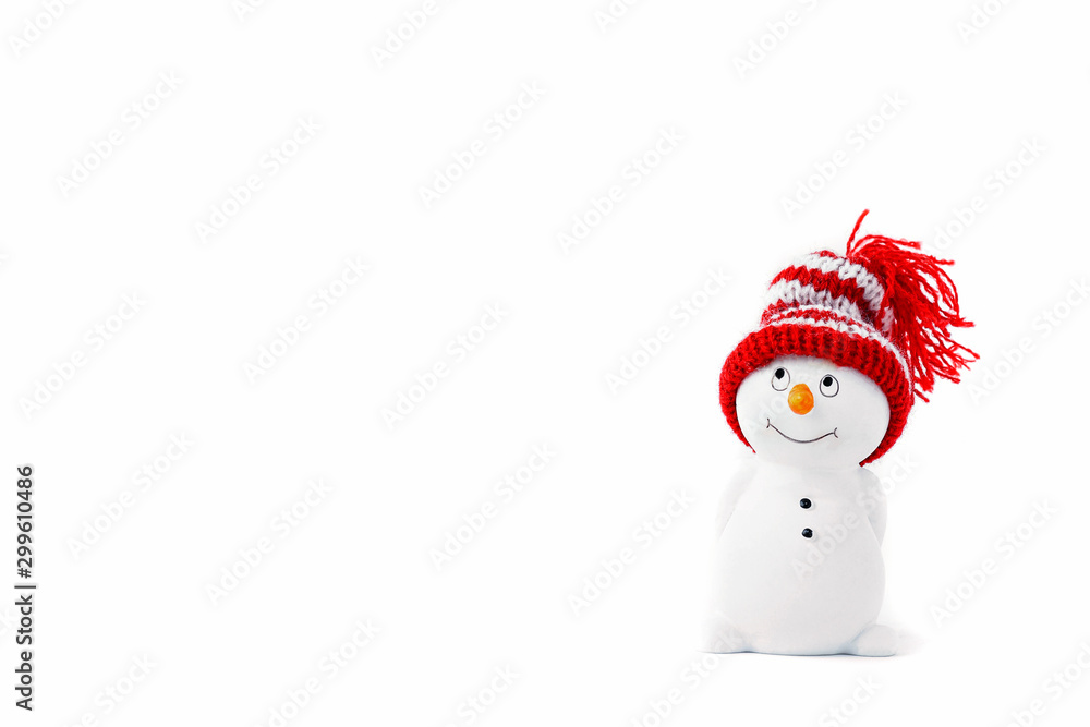 Fototapety, obrazy: Happy snowman standing isolated on white background. Merry christmas and happy new year greeting card. Funny snowman in hat on snowy background. Copy space for text