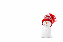 Happy Snowman Standing Isolated On White Background. Merry Christmas And Happy New Year Greeting Card. Funny Snowman In Hat On Snowy Background. Copy Space For Text