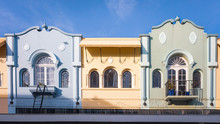 Row Of Colorful Pastel Buildings Built In The Spanish Mission Style In New Regent Street, Christchurch, New Zealand