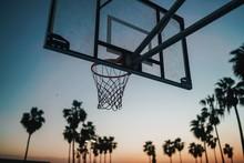 Basketball Hoop On The Beach At Sunset