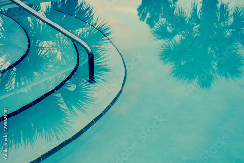 Abstract teal background with palm trees reflected into a Hollywood glamour style swimming pool Canvas Print