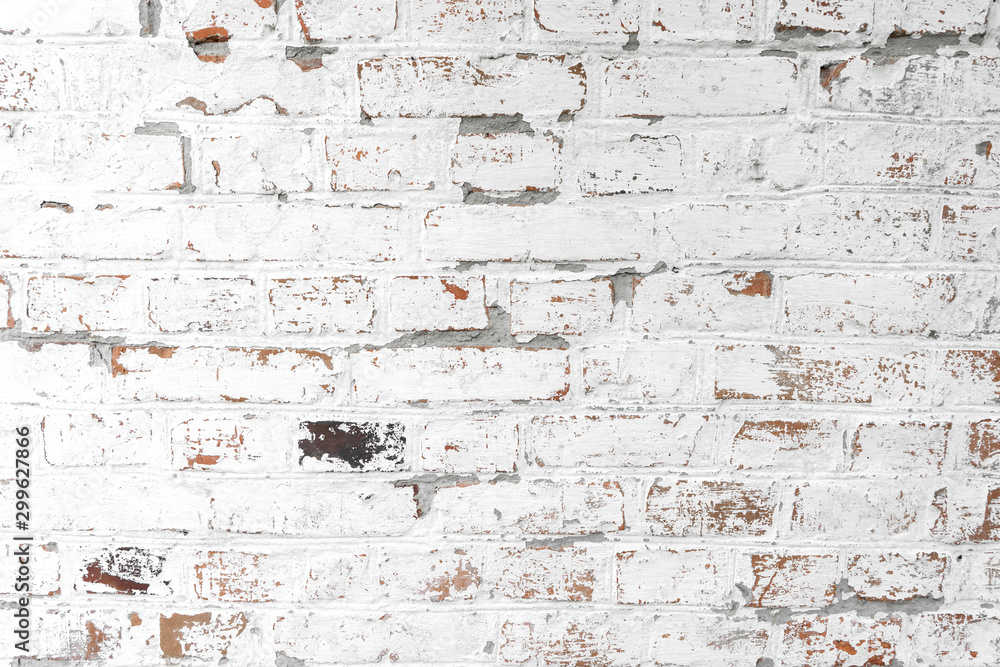 Background of old antique dirty brick wall with peeling plaster and peeling white paint, texture