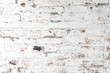 Leinwanddruck Bild - Background of old antique dirty brick wall with peeling plaster and peeling white paint, texture