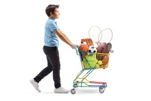 Boy Walking And Pushing A Mini Cart With Sport Items