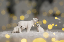 Decorative Figurines Of A Christmas Theme. Statuettes Of A Family Of Polar Bears. Christmas Tree Decoration. Festive Decor, Warm Bokeh Lights.