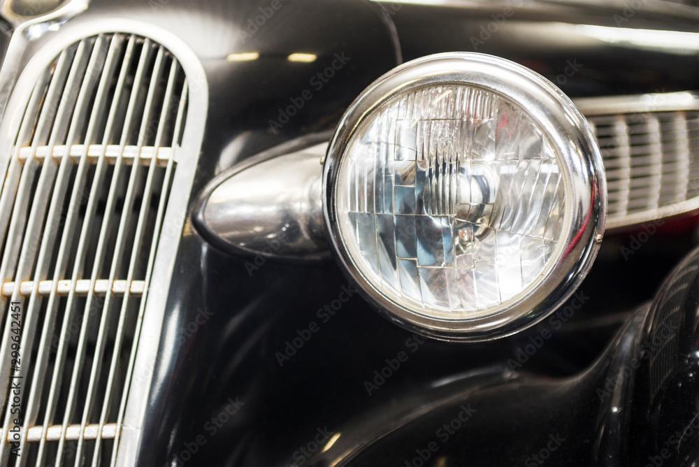 Fototapety, obrazy: Headlight lamp vintage car. Headlight lamp vintage classic car. Front part with the headlight retro car closeup