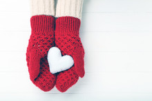 Hands In Knitted Mittens Holdi...