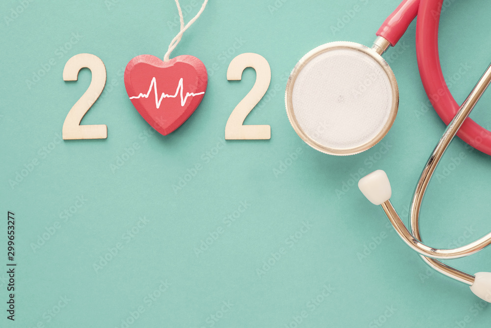 Fototapeta 2020 wooden number with red stethoscope. Happy New Year for heart health and medical concept, life insurance business