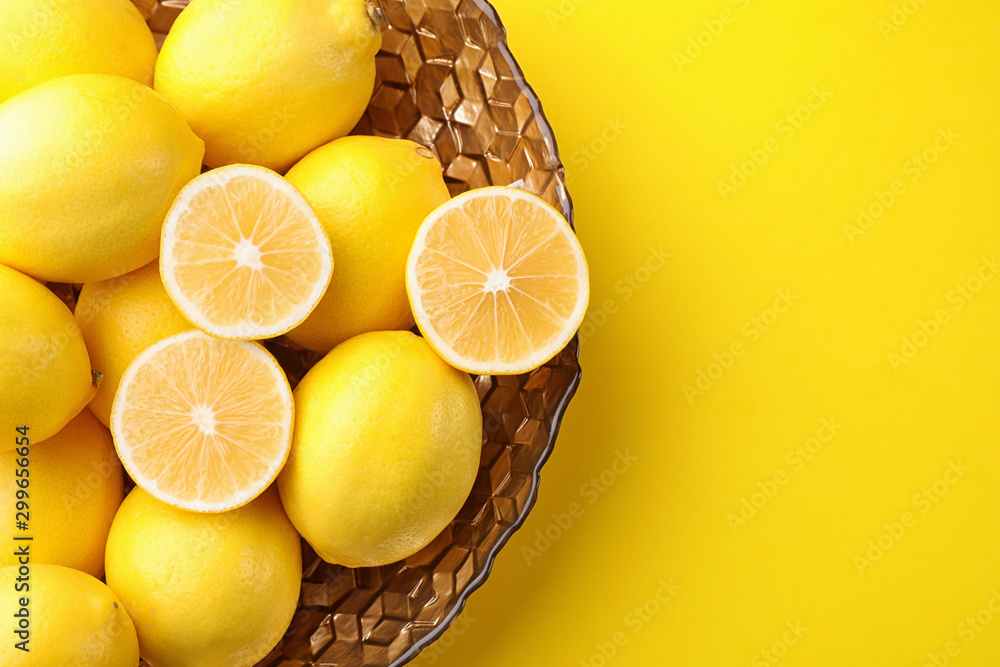 Fototapety, obrazy: Fresh lemons on yellow background, top view. Space for text