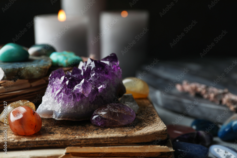 Fototapety, obrazy: Many different gemstones and blurred candles on background