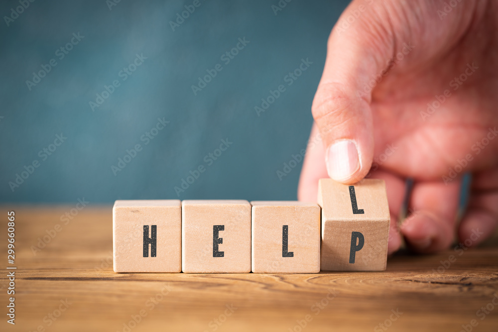 Fototapety, obrazy: hand is flipping a cube turning the word HELL into HELP on wooden background