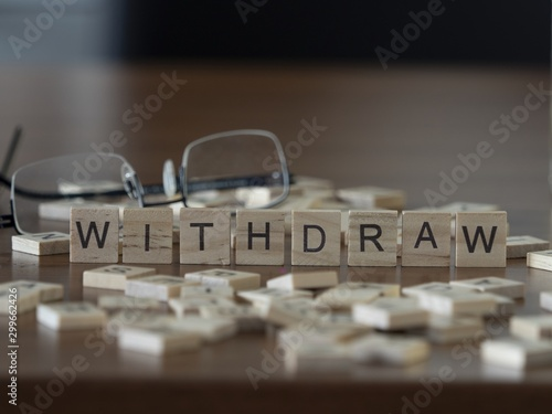 The concept of Withdraw represented by wooden letter tiles Canvas Print