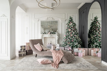Christmas Morning. Classic Luxurious Apartments With Decorated Christmas Tree And Presents. Living With Fireplace, Columns And Stucco.