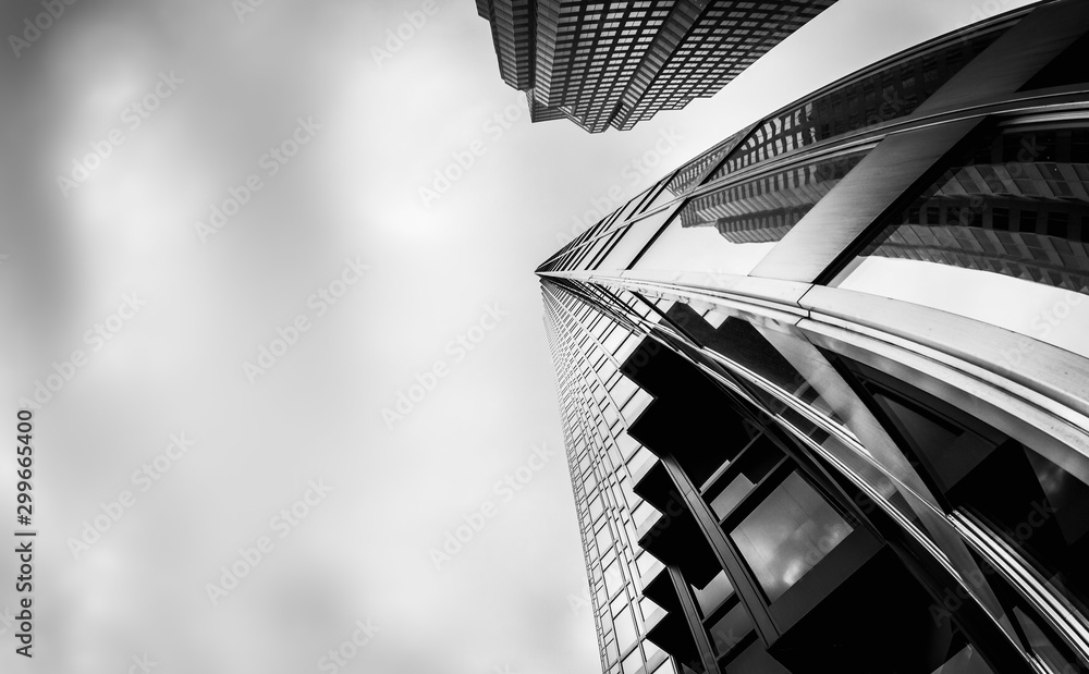 Fototapeta Greyscale low angle shot of high-rise buildings in the financial district of Toronto Canada