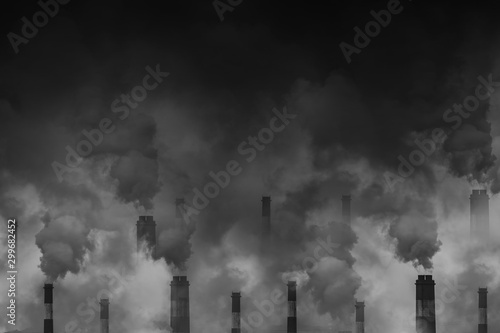 Air pollution smoke from factory chimneys dark scary sky with space for text Canvas Print