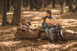 Leinwanddruck Bild - Family together reading books in the forest .