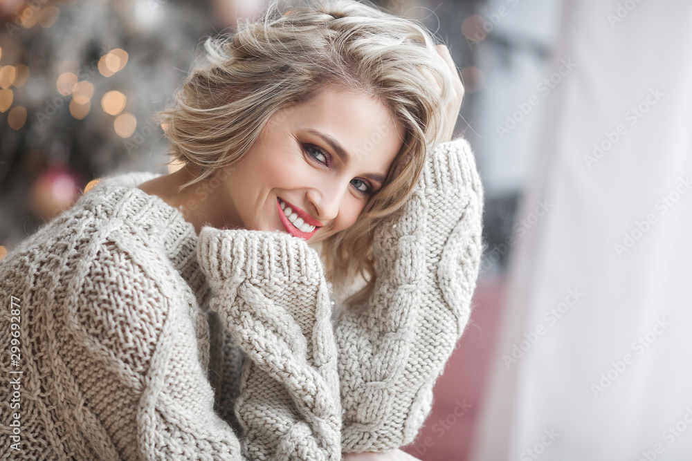 Fototapety, obrazy: Beautiful blond woman on christmas background. Beauty near cristmas tree. Close up portrait of attractive female.