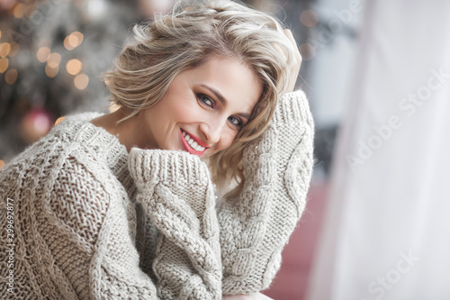 Fotografie, Obraz  Beautiful blond woman on christmas background