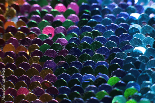 Photo Sparkling holiday macro background of bright shiny sequins and lusters