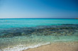 The most famous beach of Cyprus with crystal clear water. Nissi Beach.