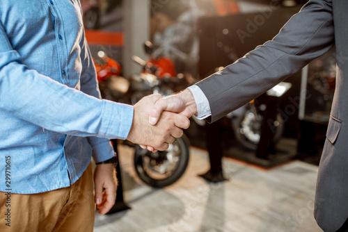 Cuadros en Lienzo Handshake in the showroom with motorcycles