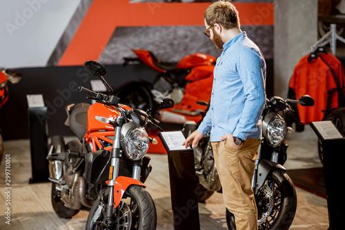 Man choosing a motorcycle in the showroom
