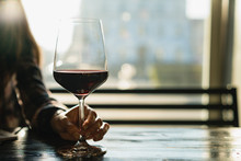 Glass Of  Red Wine On Table In...
