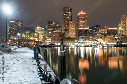 Tela  Downtown Boston, Snow-Covered Harbor Walkway, and Waterfront at Night (Winter) -