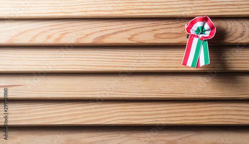 Fényképezés Hungarian cockade on wooden seamless background