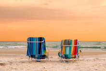 Sunset View Of Lounge Beach Chairs With Towels In Siesta Key Beach Of Florida Gulf Coast, USA