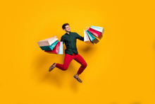Full Length Body Size Photo Of Cheerful Positive Handsome Jumping Man Holding Numerous Packages Returning From Shopping Mall Isolated Vivid Color Background
