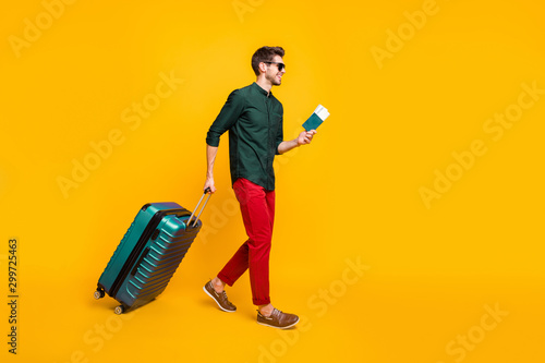 Full length body size side profile photo of man carrying his baggage holding pas Canvas Print