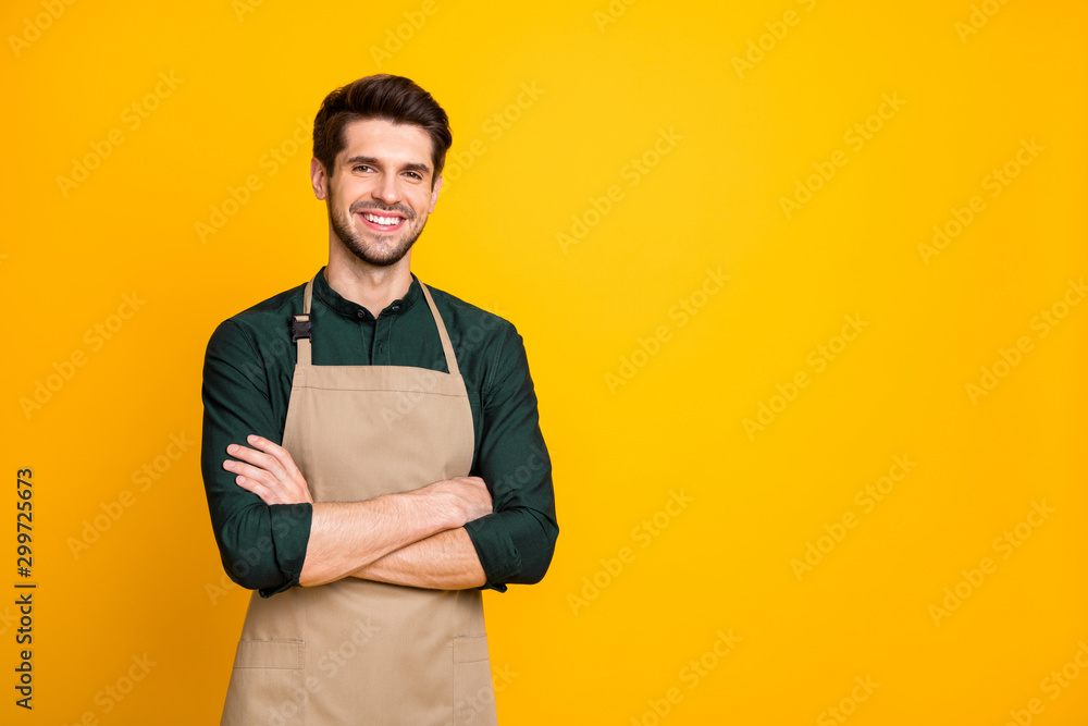 Fototapeta Photo of white cheerful positive man smiling toothily with arms crossed expressing positive emotions on face near empty space isolated bright color background